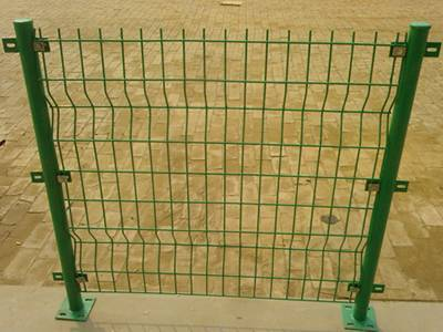 a part of fence fixed with green PVC coated round posts